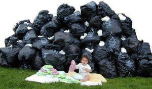 Baby surrounded by trash bags