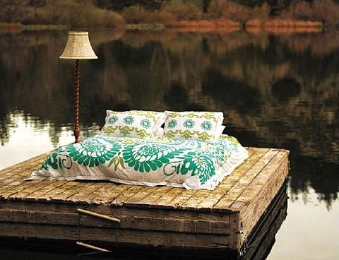 Bed floating in a lake