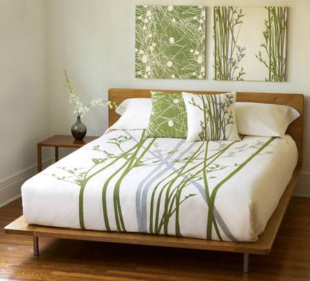 Bed with nice floral arrangement sheets