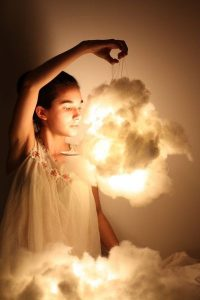 Girl holding a cotton cloud lamp