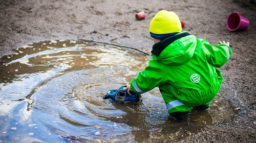 Child playing with mud