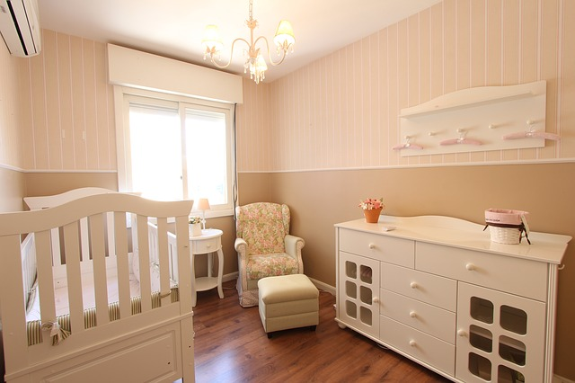 Nursery with a crib, a chair and a dresser