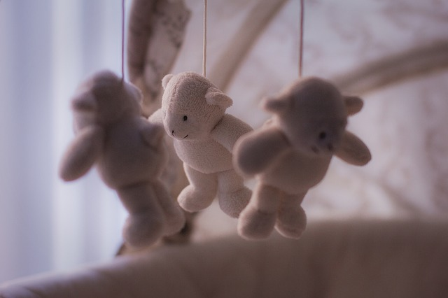 Toys hanging from a crib