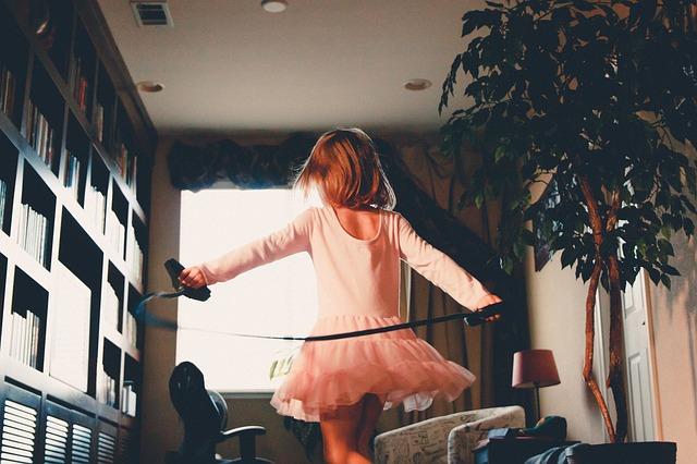Girl running near a bookshelf
